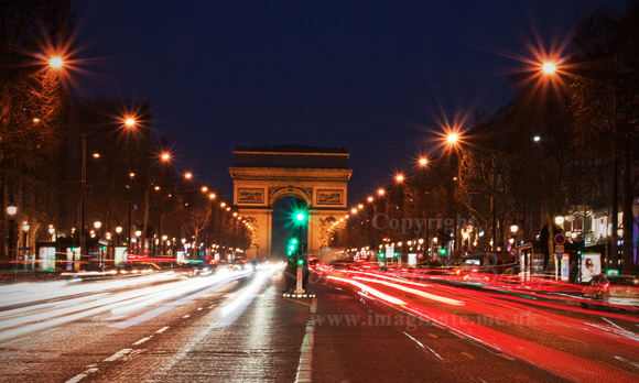 Even at night the traffic is busy on the Champs-Élysées.