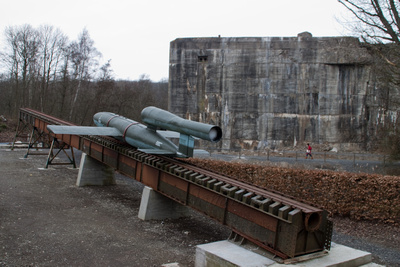 "A V1 Rocket sits on its launching ramp outside the largest ""Blockhaus"" in Northern France."